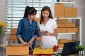 Two Asian Teenager Owner Business Woman Work At Home For Online Shopping, Checking Order  For Delive poster