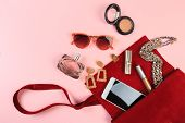 Top View Of Women Bag And Lady Stuff With Copyspace On Pink Background - Image poster