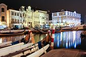 Night View The Traditional Moliceiro Boats In The Canal Of Aveiro City, In Portugal