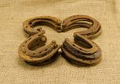 Concept Clover Retro Horseshoes Linen Background
