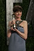 WEST HOLLYWOOD, CA - FEB 24: Anne Hathaway at the Vanity Fair Oscar Party at Sunset Tower on Februar