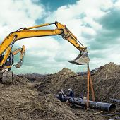 stock photo of heavy equipment operator  - Construction site - JPG