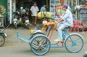 HO CHI MINH CITY, VIETNAM - JANUARY 5: An unidentified cycle rickshaw driver rides on January 5, 201