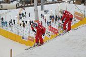 BUKOVEL, UKRAINE - FEBRUARY 23: Instructors prepare the slope for aerial skiing during Freestyle Ski World Cup in Bukovel, Ukraine on February 23, 2013.