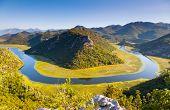 Sinuous river flowing through mountains. Rijeka Crnojevica. Located near Skadar Lake, Montenegro, Eu