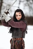 picture of revolt  - Woman in the medieval costume holding a sword - JPG