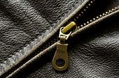 stock photo of zipper  - Deep textured leather jacket with brass zipper - JPG