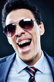 Portrait of shouting man in sunglasses and dental braces