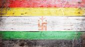 stock photo of jain  - Jain flag painted on grungy wood plank background - JPG