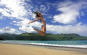 Young Woman In Bikini Jumping At Rincon Beach, Samana Peninsula