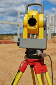 picture of theodolite  - Surveyor equipment theodolite outdoors at construction site - JPG