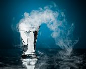 shot glass of vodka with ice vapor
