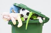 pic of dustbin  - A closeup of unwanted toys in a dustbin - JPG
