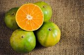 stock photo of mandarin orange  - mandarin orange Tangerines sweet green thai orange on natural linen - JPG