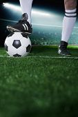 Close up of feet on top of soccer ball