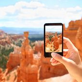 Smart phone camera taking photo picture of Bryce Canyon nature. Closeup of mobile phone camera screen photographing beautiful american landscape Bryce Canyon, Utah, United States.
