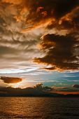 stock photo of mammary  - Mammatus clouds forming at sunset ahead of severe thunderstorm - JPG