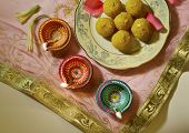 Indian sweets with traditional lamps- top angle