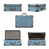 Small blue vintage suitcase in different views, isolated on white.  My old childhood school case.