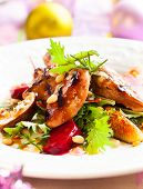 Grilled quail breasts with fig and beet salad for holiday