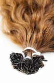 image of hair streaks  - Extensions for brown hair isolated on a white background - JPG