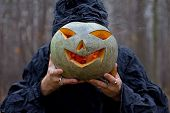 Stranger has pumpkin instead of his head