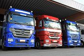 Row Of Mercedes-benz Actros Trucks In Carport