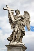 Angel With Cross At The Famous Sant' Angelo Bridge In Rome, Italy