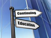 Education concept: Continuing Education on Building background