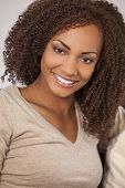A beautiful mixed race African American girl with perfect teeth and smile