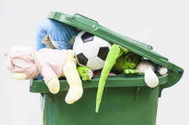 picture of dustbin  - A closeup of unwanted toys in a dustbin - JPG