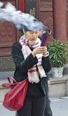 Shanghai.china - Nov. 15.2013. Woman In Buddhist Temple