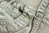 foto of khakis  - Macro of khaki pants pocket cotton textile great details - JPG