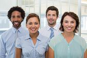 pic of half-dressed  - Group portrait of smiling young business people in the office - JPG