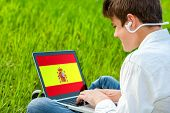 Teen Student Doing Spanish Course On Laptop.