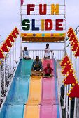 Family Rides Fun Slide At Atlanta Fair