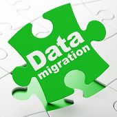 Information concept: Data Migration on puzzle background