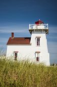 Lighthouse on hill in North Rustico, Prince Edward Island, Canada