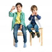 Kids Doing The Ok Sign Over White Background