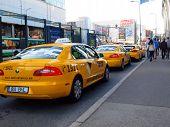 Tallinn Street And Original Yellow Taxi Tallink Takso