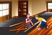 Young Couple Installing Hardwood Floor