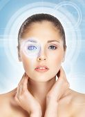 Young and attractive woman from future with the laser hologram on her eyes (eye scanning technology,