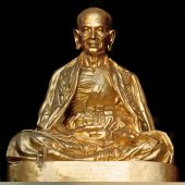 image of siddhartha  - A golden Buddha statue outside of a temple in Thailand - JPG