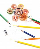 Colorful pencils and pencil shavings, isolated on white