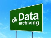 Data concept: Data Archiving and Gears on road sign background
