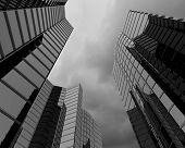 Bottom image of skyscraper with thunder lightning in sky