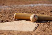 Baseball and Bat at Home Plate Close Up