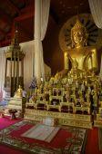 stock photo of siddhartha  - A golden Buddha statue inside a temple in Thailand - JPG