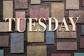 stock photo of tuesday  - Wooden letters forming words TUESDAY written on wooden background - JPG