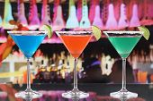 Colorful Cocktails In Martini Glasses In A Bar